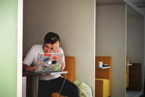 Man at desk stressed at new job