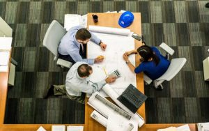birds eye view of three people at business meeting
