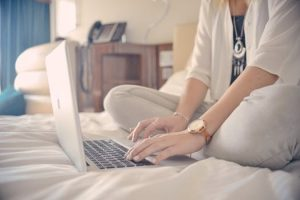Blogger at home on laptop planning how to increase clicks